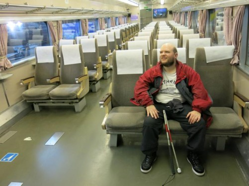 Tony sitting in a carriage of the famous Japanese Bullet train.