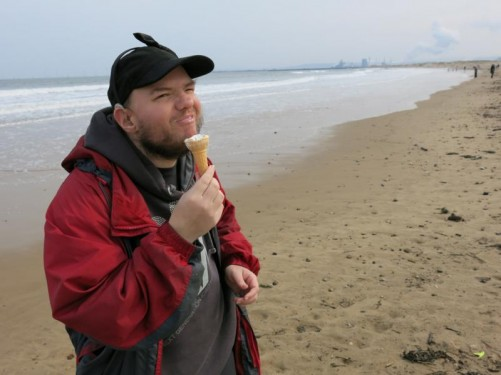 Again Tony eating the ice cream and a good view along the beach. On the horizon steam can be seen rising from the Teesside Steelworks at Redcar.
