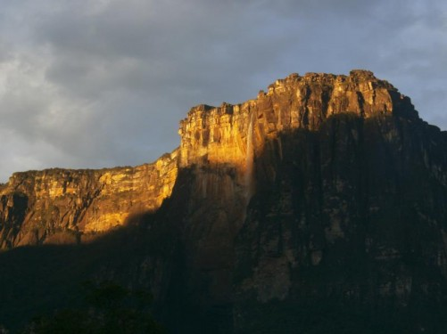 The sun lighting up the top of Auyantepui and Angel Falls away in the distance.