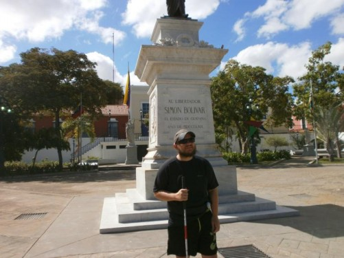Tony in front of a statue of Simon Bolivar in the main square.
