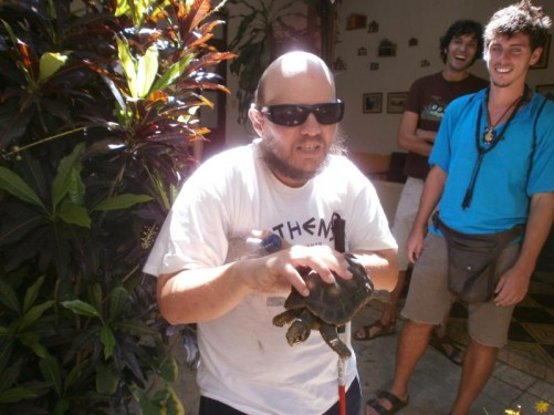 Tony holding a tortoise in the hostel where he stayed in downtown Merida, a short walk to Plaza Bolivar.
