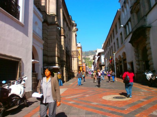 People walking along a pedestrian street in the historic centre of Quito, close to Independence Square.