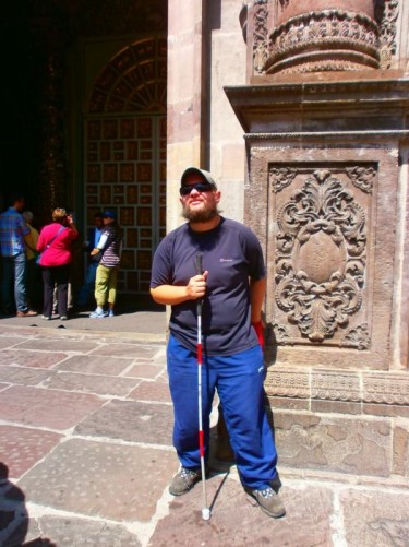 Tony outside the main doorway belonging to the Church of the Society of Jesus (Iglesia de la Compañia de Jesus)