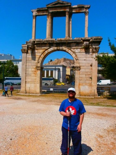 Tony at Hadrian's Arch. A Roman monumental gateway that spanned an ancient road leading into the centre of Athens.