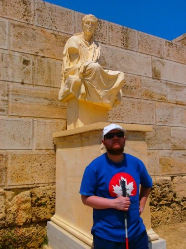 Tony in front of a statue of classical dramatist Menander (born circa 341/42 BC). Located at the Theatre of Dionysus Eleuthereus.