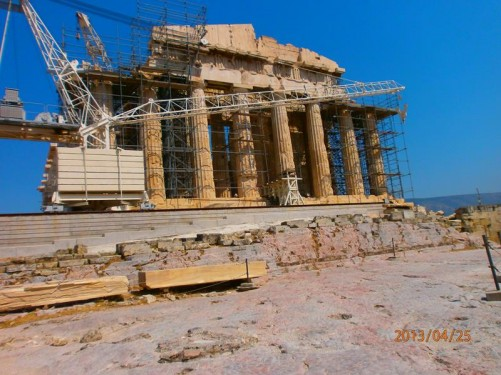 The Parthenon sitting prominently on the Acropolis. It is the most important surviving building of Classical Greece and is widely regarded as an enduring symbol of Ancient Greece, Athenian democracy and western civilization. Its construction began in 447 BC and it was completed in 438 BC, although decoration of the building continued until 432 BC. From this angle it is partially covered with scaffolding due to ongoing restoration work.