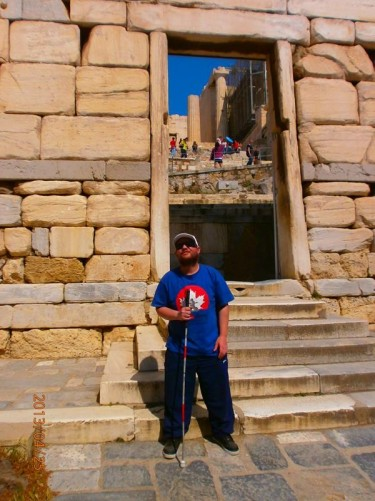 Tony standing in front of Beule Gate. Today visitors pass through here when leaving the Acropolis. It was built in the third century AD. It stands to the west of the Propylaia.