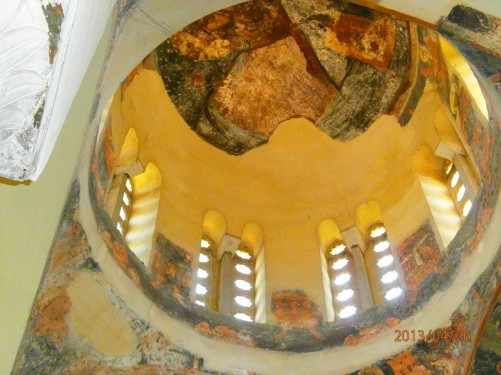 Looking up into the dome of the church. Fragments of 17th century wall paintings can be seen.
