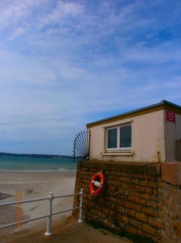 View of a sandy beach, St Aubin's Bay.