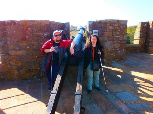 Tony and Tatiana by a canon on the castle walls.