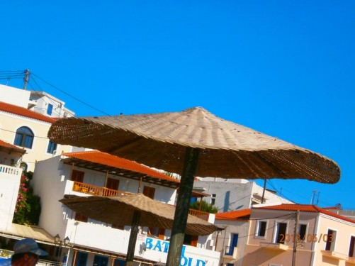 Wicker sun umbrellas on the beach.