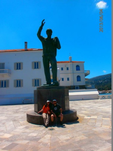 Tatiana and Tony sitting at the base of the Statue of the Unknown Sailor. It is dedicated to all those sailors who have died at sea. Located in a marble square with views of the sea below.