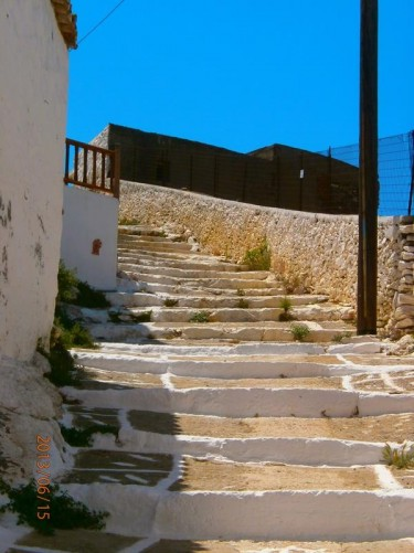 A longer flight of uneven stone steps.
