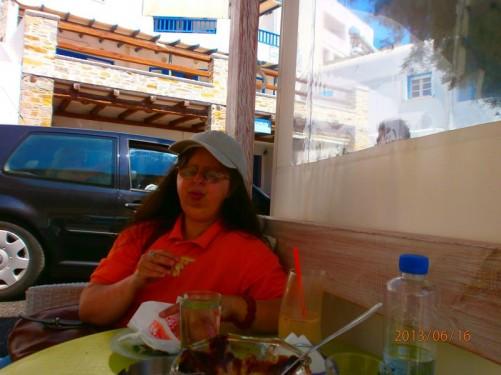 Tatiana sitting at a café table.