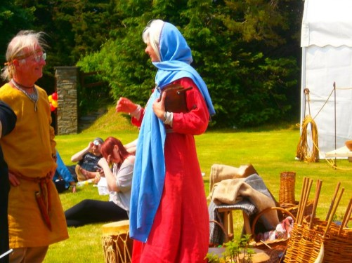 A man and woman in period dress, taking part in some sort of historic re-enactment. This was one of the many events taking place to celebrate Tynwald Day, the Isle of Man's national day, which is on 5th July (unless it is a Saturday or Sunday, when it moves to the following Monday). The location is Tynwald Hill, located in the centre of the island.