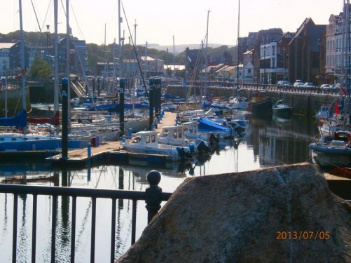 Boats in Peel's Inner Harbour. Located on the island's west coast, Peel is the Isle of Man's third largest town after Douglas and Ramsey.
