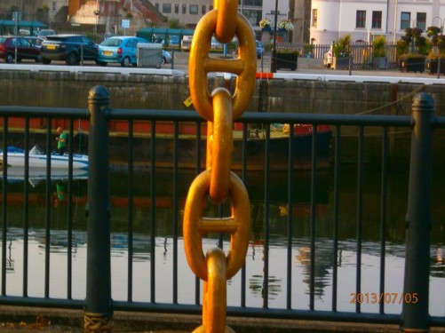 A heavy chain, now painted gold and used decoratively, in the vicinity of Douglas Harbour.
