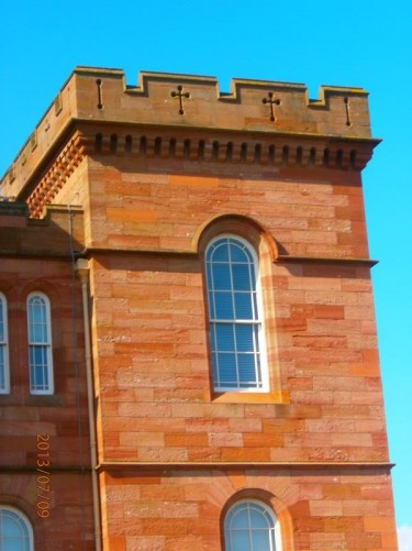 A decorative red sandstone tower at one corner of Inverness Castle.