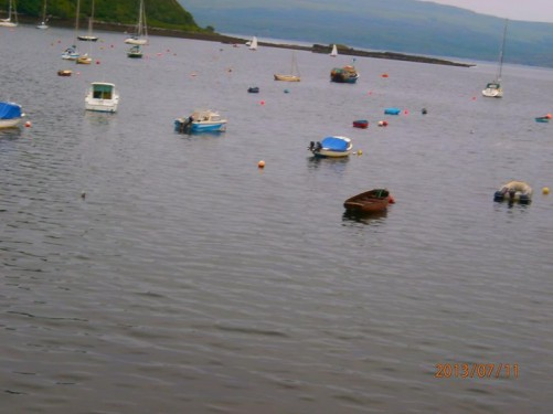 Small boats moored in the harbour at Portree.