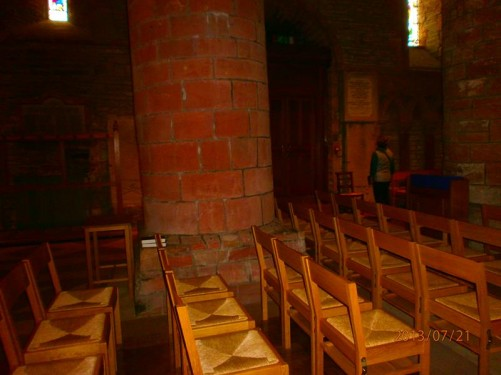 Inside St Magnus' Cathedral. Stone columns. Rows of seats. The cathedral is Romanesque in style. Construction commenced in 1137 and it was added to over the next three hundred years. It is the most northerly cathedral in the British Isles.