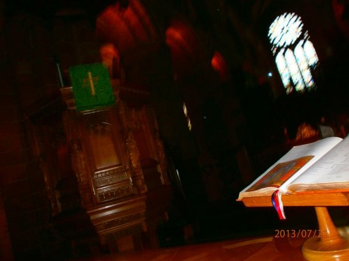 Near the altar inside St Magnus' Cathedral. Bible on a lectern.
