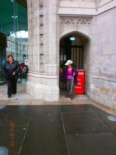 Tatiana standing in a doorway at the Marischal College entrance.