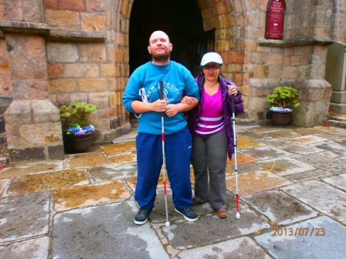 Tony and Tatiana outside the entrance to the Cathedral Church of St Machar.