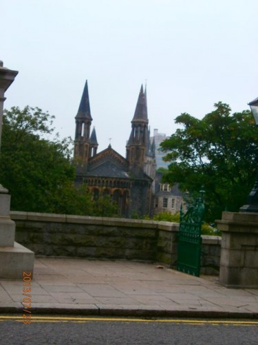 View from Union Terrace over Union Terrace Gardens to the 19th century former St Nicholas Congregational Church with tall narrow towers on its corners. It is now used as a bar and nightclub.
