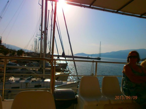 On-board the boat at the start of the day cruise. Smaller sailing boats alongside in the harbour at Agia Eufemia.