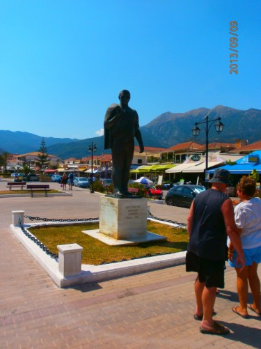 By a statue of Aristotle Onassis, at Nidri, the largest resort on Lefcada.