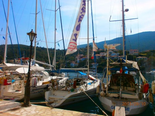 Row of yachts moored in the harbour.