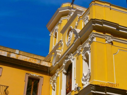 Yellow-painted façade of the Baroque style Church del Carmine in Piazza Tasso.