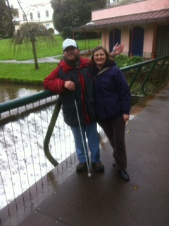 Tony and Annette on a bridge over Dawlish Water.