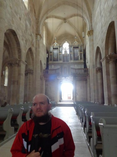Inside St Michael's Cathedral. Tony standing in the middle of the central aisle. This Roman Catholic cathedral was built between 1247 and 1290 in Romanesque style.