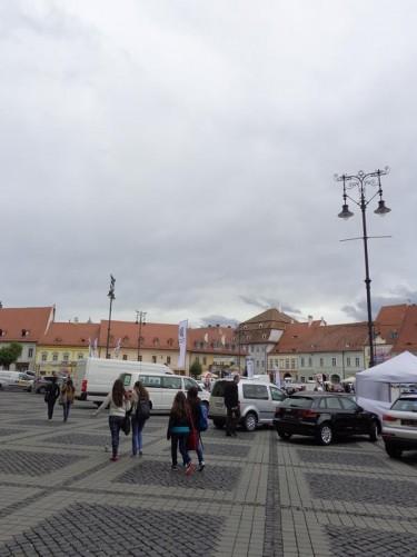 Entering Grand Square (Piața Mare) at the northeast end of Strada Nicolae Bălcescu, upper town.