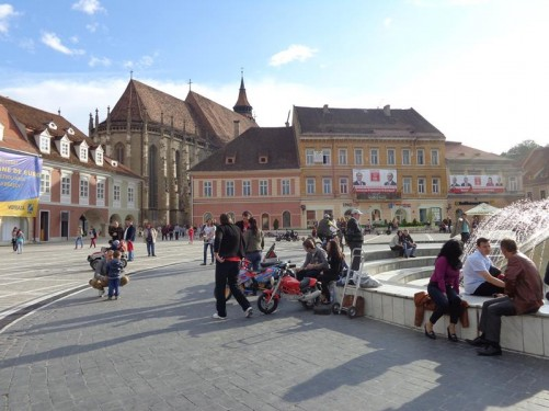 The southwest corner of Council Square with the Black Church (Biserica Neagră) visible beyond.