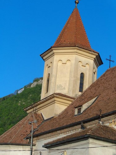 The tiled roof at the side of St. Nicholas Orthodox Church. A turret-like tower protruding.