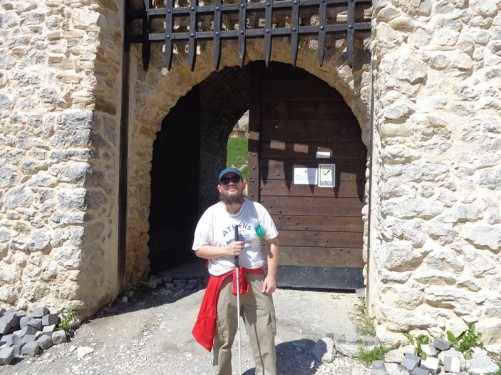 Tony outside a stone gateway into Râșnov Fortress. A portcullis reconstructed in wood above. The fortress was built as part of a defence system for the Transylvanian villages at risk of outside invasion. It is said to date from the 13th century. Râșnov is located about 10 miles (16 kilometres) from Brașov. It can be easily reached by bus.