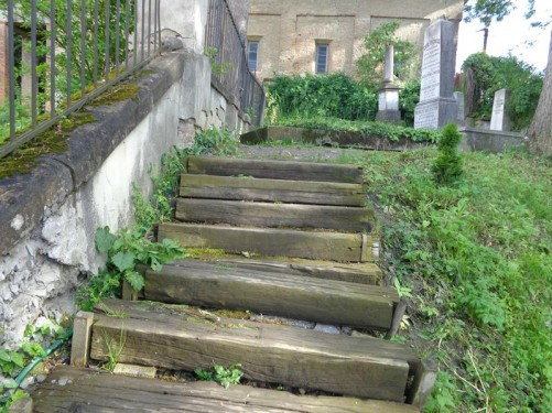Wooden steps leading up to graves in a Lutheran cemetery next to the Church on the Hill.
