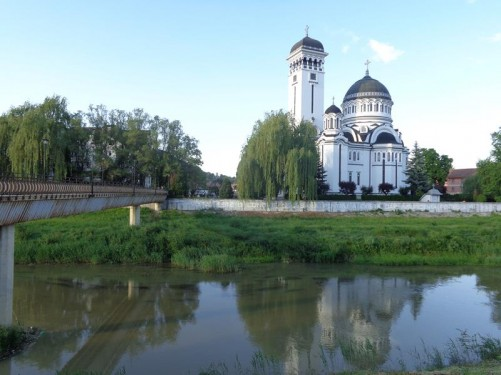 In the Lower Town (Orasul de Jos), beneath the Citadel, looking across the Târnava Mare River to the Orthodox Cathedral (Catedrala Ortodoxa). The cathedral was built in Byzantine style between 1934 and 1937 and strikingly painted in black and white. It is accessible via a footbridge over the river that can be seen to the left.