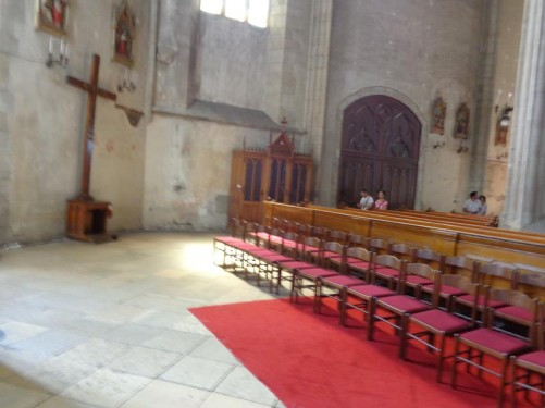 Near the front of St Michael's Church looking back at rows of chairs and pews.