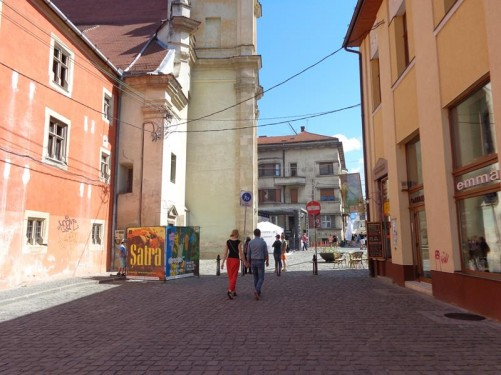 View towards the front side of the Franciscan Church. The church stands at the east end of Museum Square (Piața Muzeului).