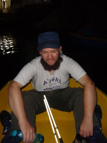 Tony sitting in a boat on the lake. The lake is up to 8 metres deep.