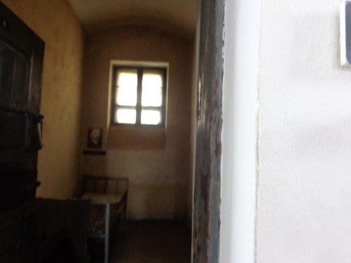 A prison cell inside the former Maramureș County prison, which was built in 1897. The Securitate of the Romanian Communist regime ran the prison during the 1950s and 1960s as a place for the detention and political repression of public figures who had been declared