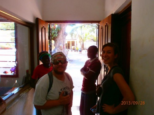 Tony standing with a female traveller from Belgium at the ticket office of Kijiji cha Makumbusho (Village Museum).
