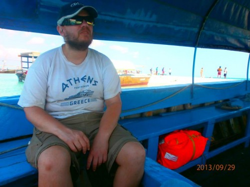 Tony in a dhow, still beached on the shore, waiting to travel to Changuu Island (also known as Kibandiko, Prison or Quarantine Island). The dhows are now motorised to speed the journey.