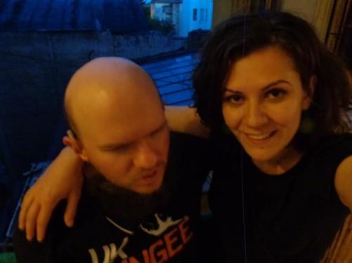Andreea and Tony on the balcony of Downtown Hostel Timișoara. Andreea part owns the hostel.