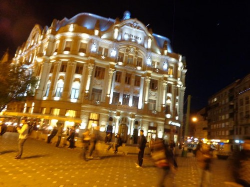 The grand looking Universitatea Politehnică (University Polytechnic) building on the north-west side of Victory Square. Lit up in the semi-darkness.