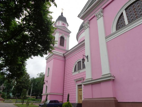 The side of the Holy Spirit Orthodox Cathedral. This is the main orthodox church of Bukovina region. Construction began in 1844 and it was consecrated in 1864. There are three domes on the roof, plus two smaller cupolas on towers at the front. The walls are painted bright pink.