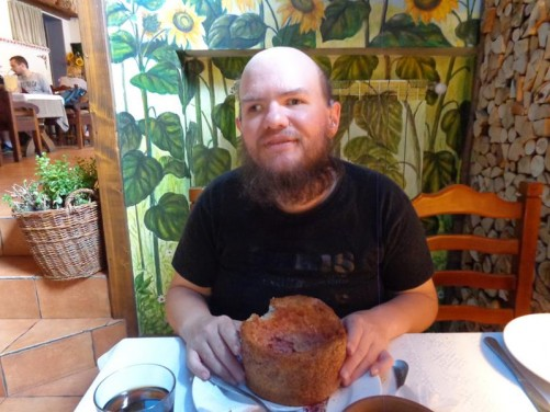 Inside a restaurant. Tony eating local soup from a bowl made of bread!